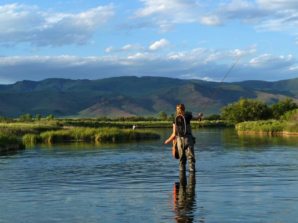 Female Fishing River with Fly Fishing Waders