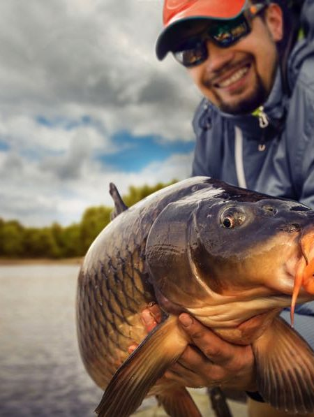 Fly Fishing for Carp in Iowa on a River holding a fish