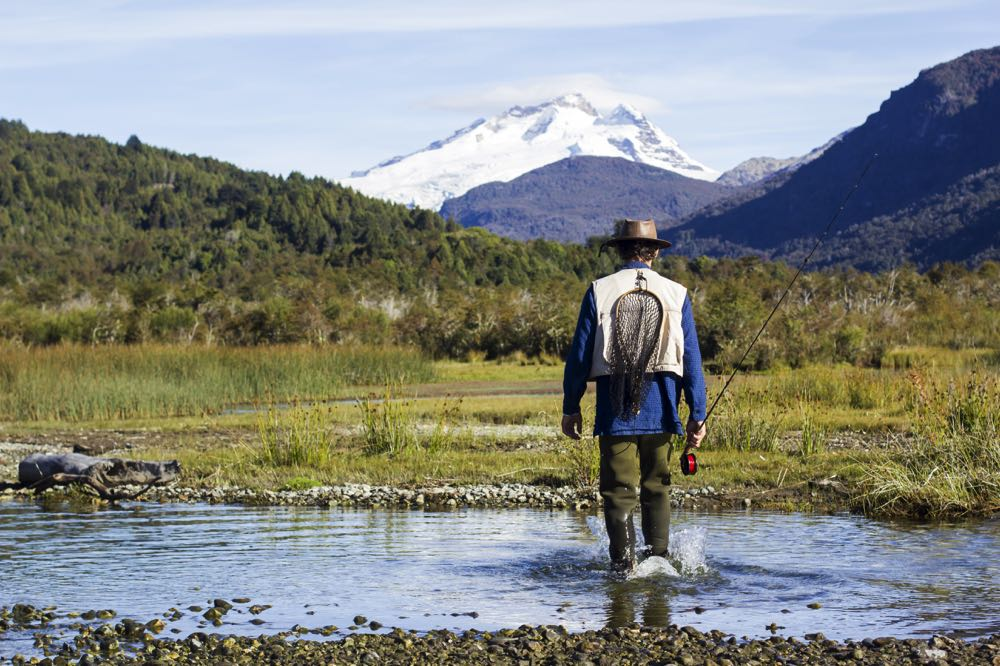 Fly Fishing with a 4 weight fly rod on a river with mountains