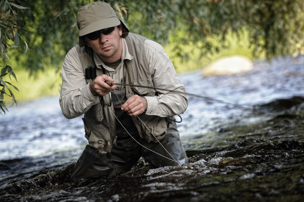 Man Fly Fishing with a good fly fishing waders