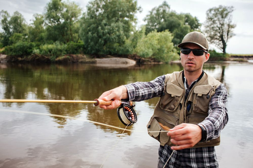 Man On River Wearing Top Fly Fishing Sunglasses