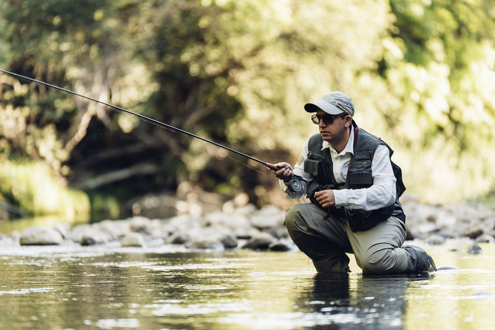 Man fly fishing wearing the best sunglasses with polarized lenses