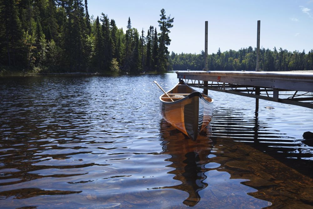 Trout Lake Minnesota Canoe for Fly Fishing Tied to Dock