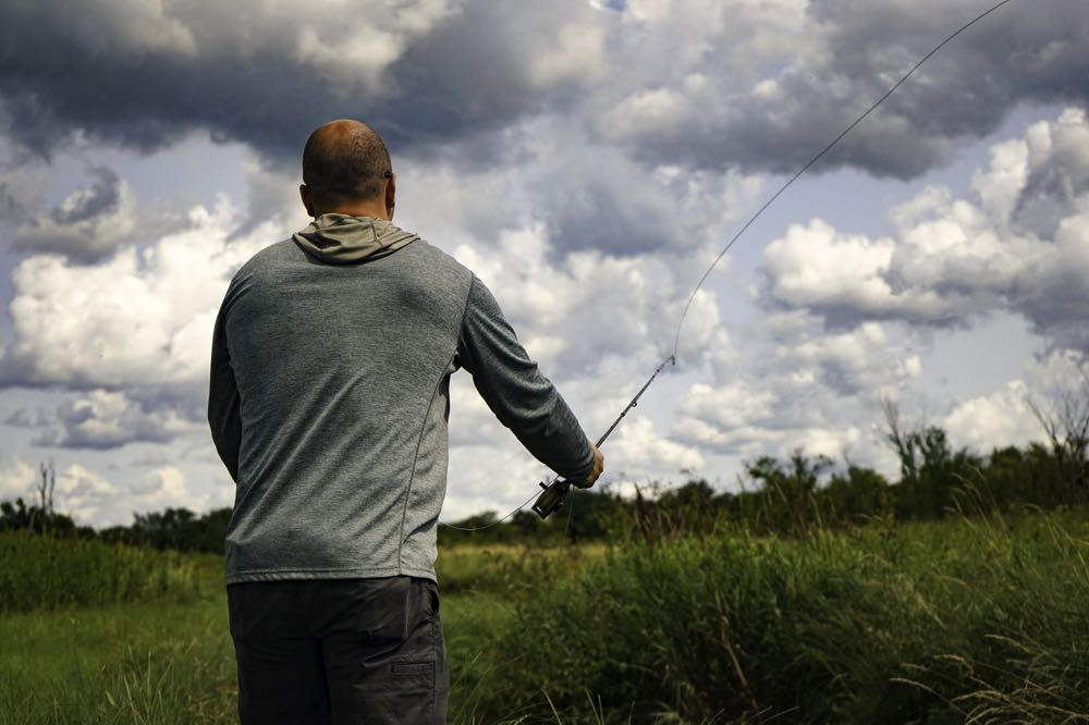 Man Cast Fly Line on a river During Fishing Season in Wisconsin