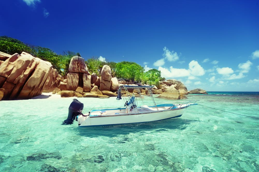 Boat for Fly fishing in the Seychelles Floats in a quiet bay
