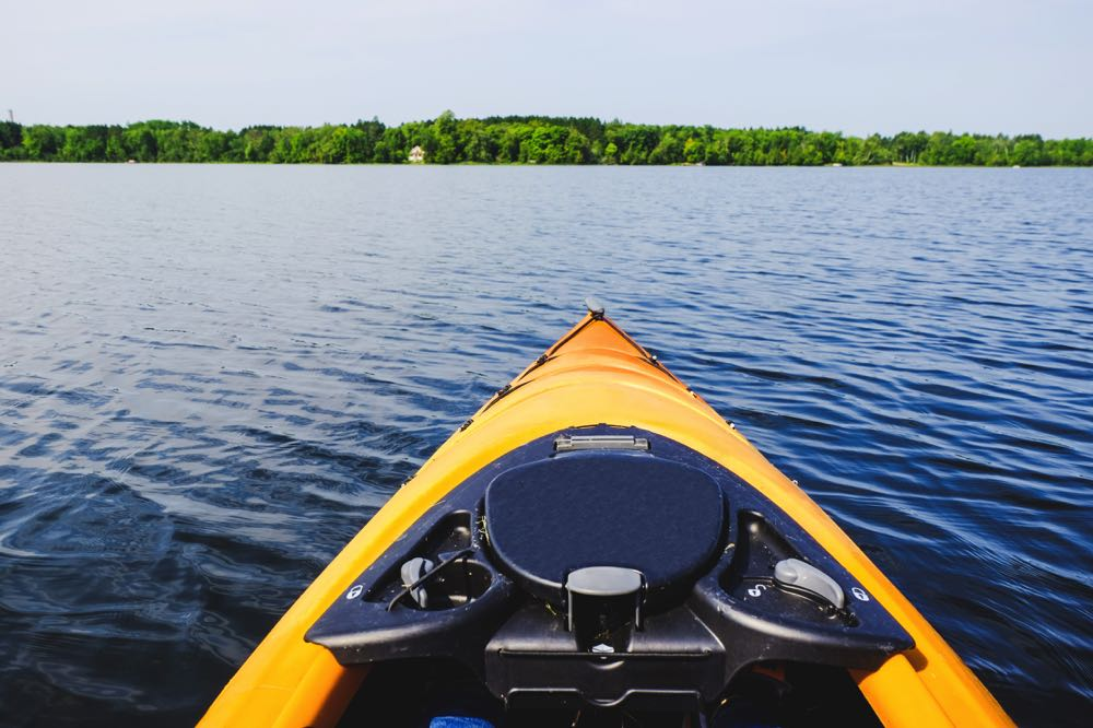 Fishing Kayak on a lake front of boat view