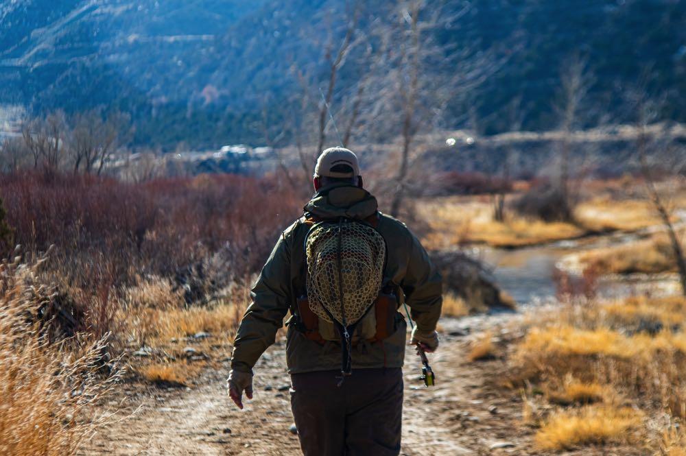 Fly Fishing New Mexico Man Walks Down Path