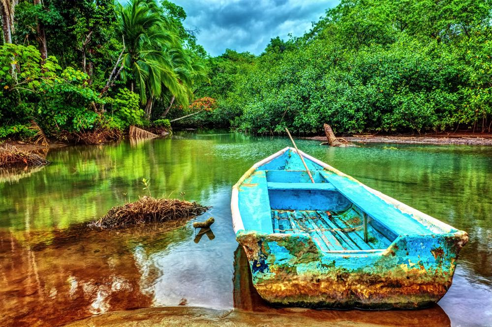 Old Boat By a Tropical River