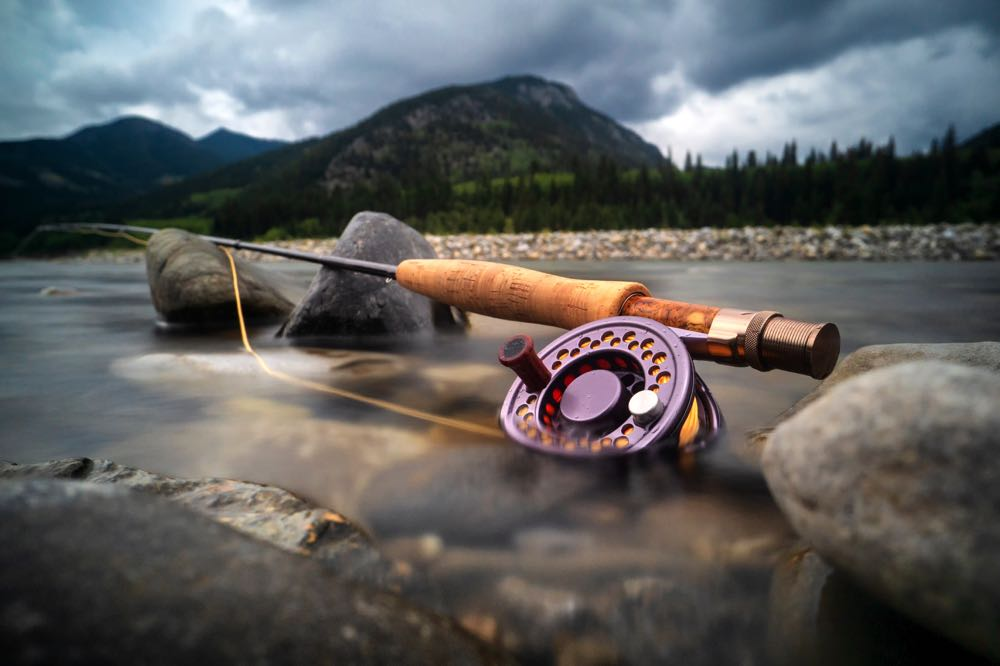 Rod and Reel in Cold River Fly Fishing Alberta