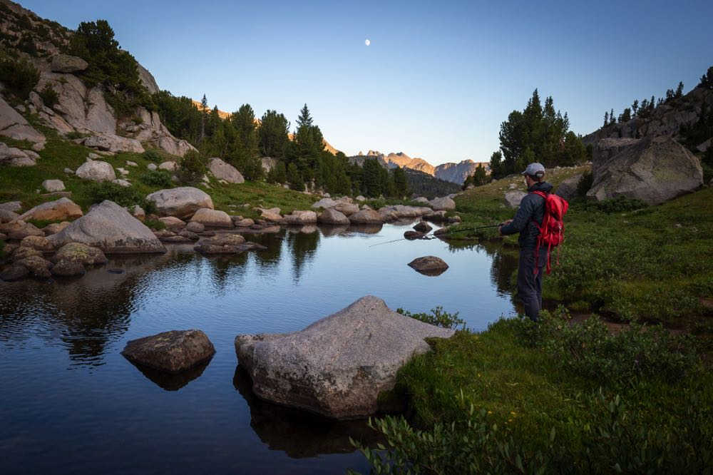 Wyoming Wind River fly fishing with a backpack on