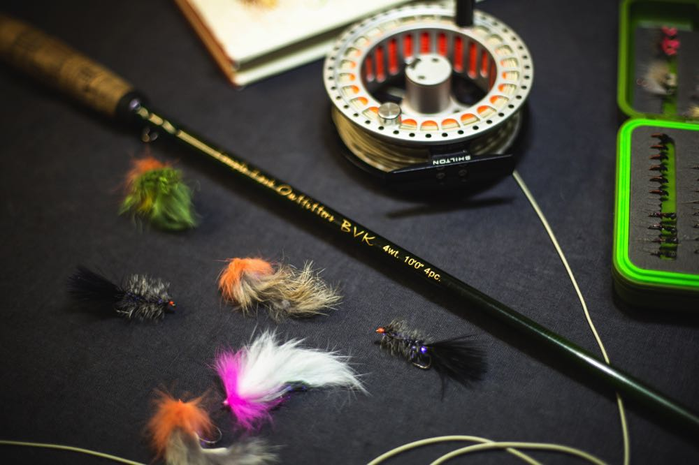 TFO BVK Fly Rod on a table with flies, reel and fly box