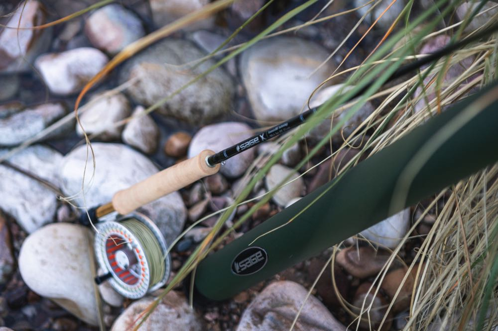 Sage X Fly Rod On River Stones
