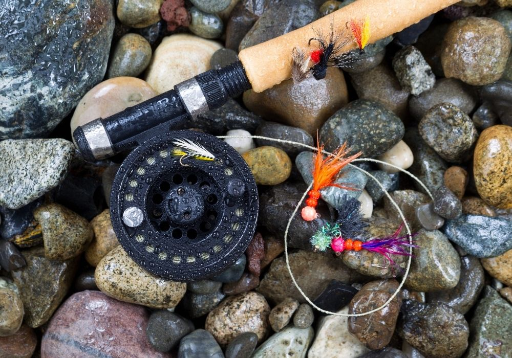 A fly rod and reel on the rocks