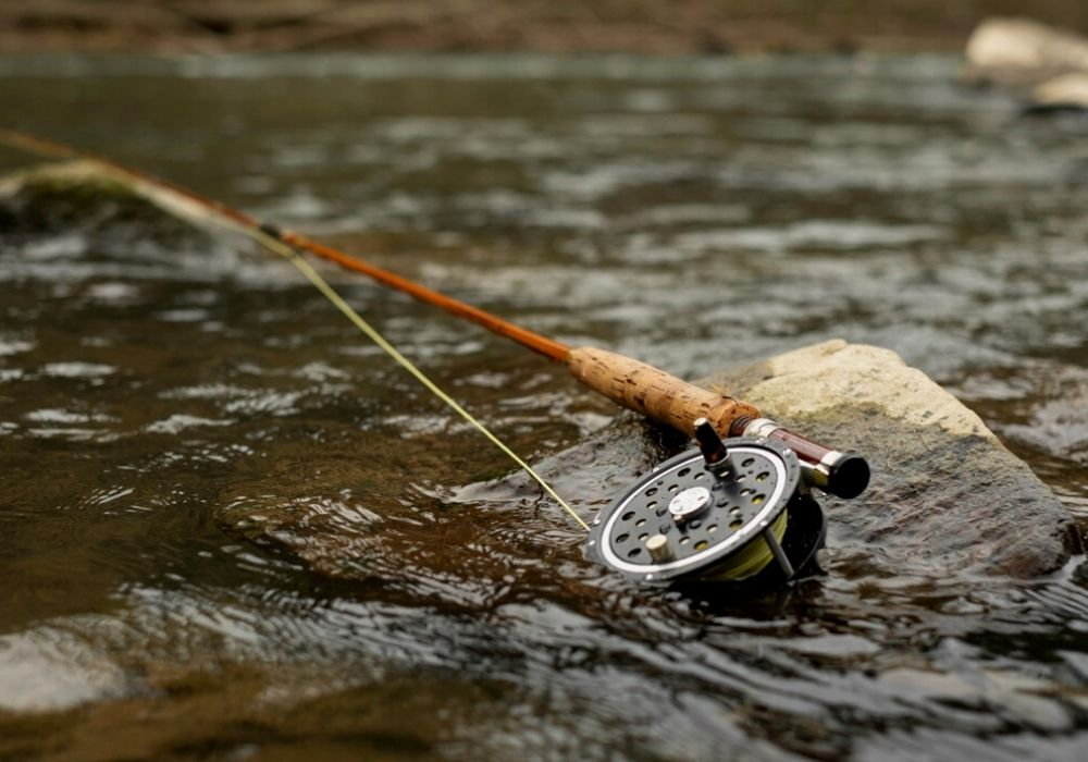 A vintage bamboo fly rod on a streamside