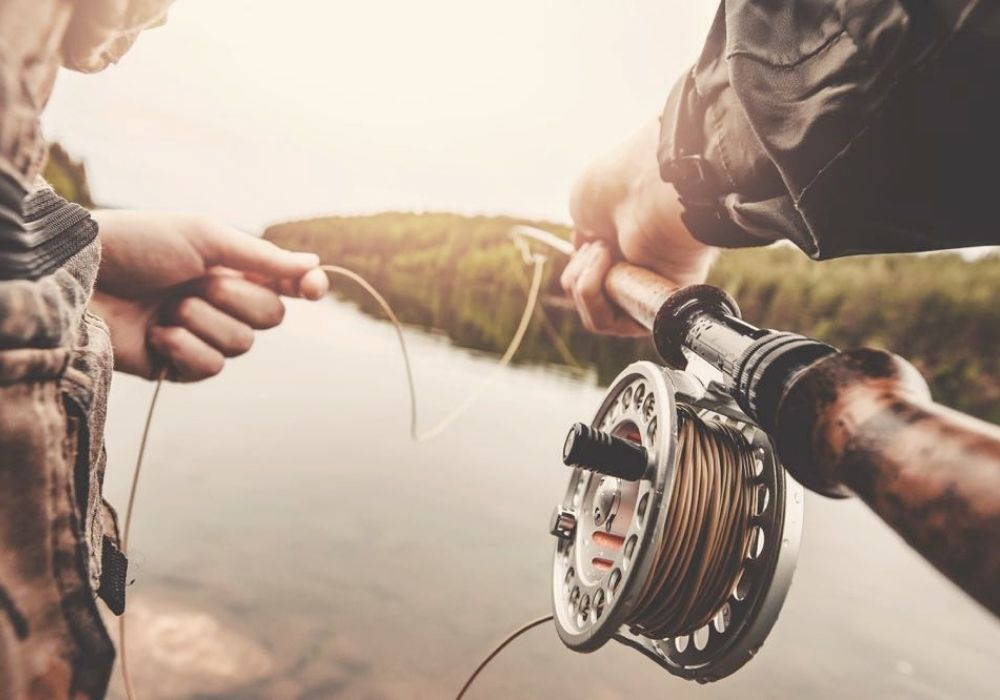 a man fishing with his fly fishing gear a fly rod and reel on the river
