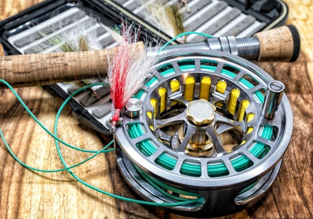 a set of fly fishing gear with a fly reel and fly rod