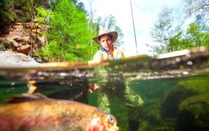 A fly angler caught a huge fish on a wet fly fishing