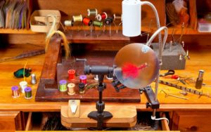 A perfect fly tying desk full of fly tying materials.