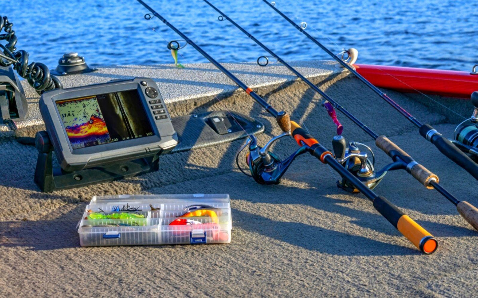 Fishing tackle set and fishfinder, echolot, sonar at the boat.
