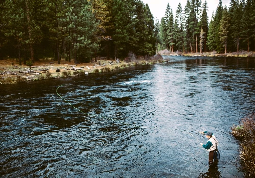 An angler fly fishing on a river in Bend, Oregon