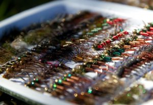 a box of fly fishing nymph flies for trout