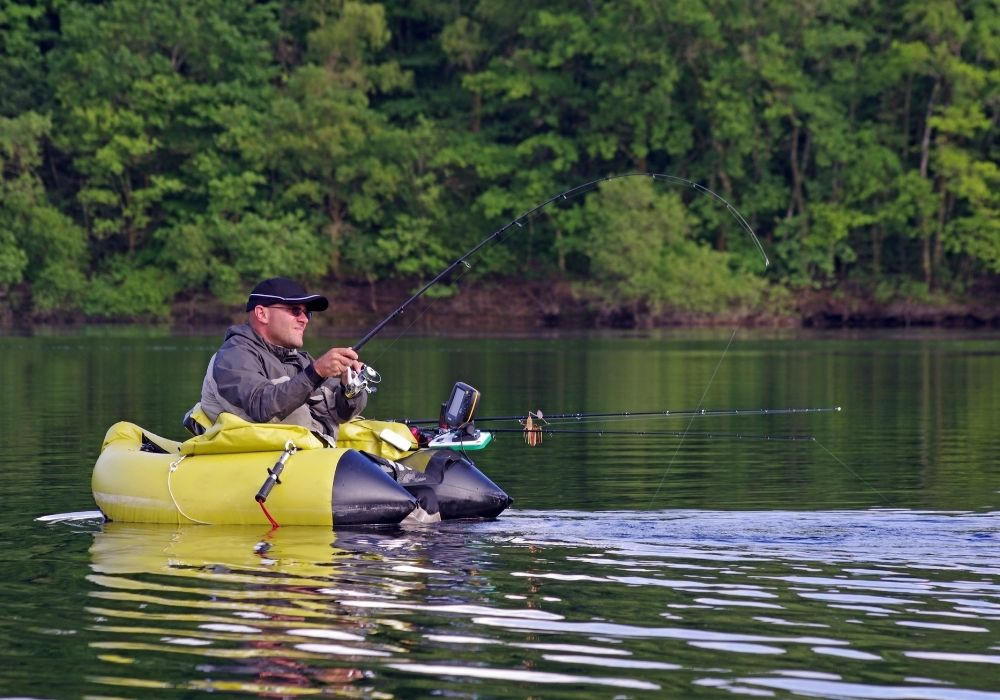 an angler fly fishing from a float tube in the lake