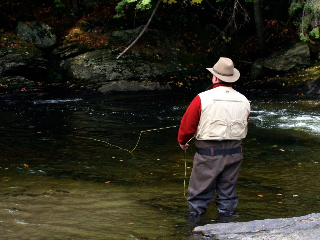 A man fly fishing in a cool Vermont stream