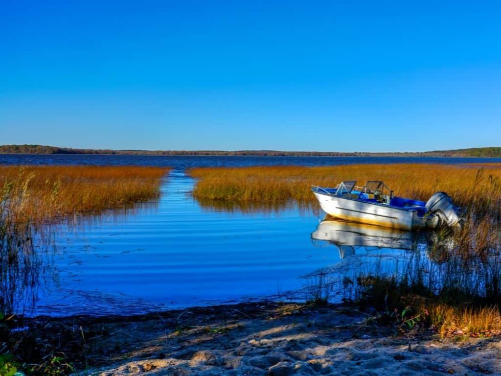 boat on scenic Worden Pond in Rhode Island